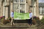Stormont Estate management unit staff pictured holding a green flag award banner for 2017