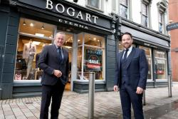 Finance Minister Conor Murphy with Gary Keenan, of Bogart Menswear