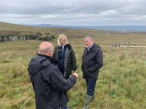 Finance Minister Conor Murphy with Jennifer Fulton, CEO of Ulster Wildlife, and Jim McAdam, Ulster Wildlife.