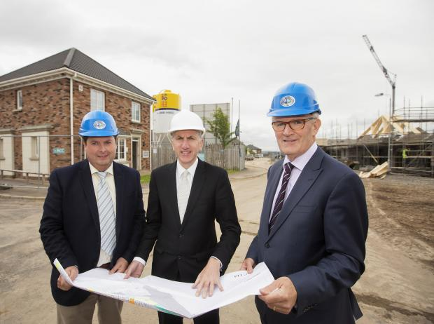 Finance Minister Máirtín Ó Muilleoir MLA pictured with John Armstrong, managing director CEF and David Magee, Antrim Construction Company LTD