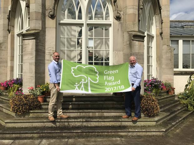 Stormont Estate management unit staff pictured holding a green flag award banner for 2017