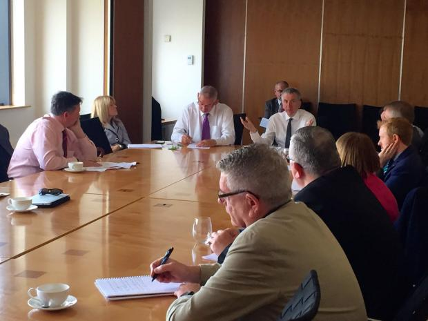 Finance Minister pictured as he met business, union and community leaders to discuss EU Referendum implications for the north
