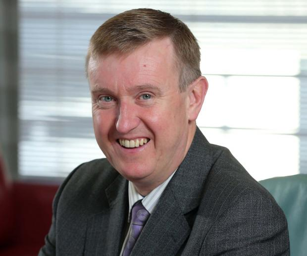 Minister Mervyn Storey